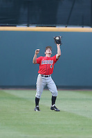 Justin Behnke (4) of the Arizona Wildcats catches a fly ball during a game against the UCLA Bruins at Jackie Robinson Stadium on May 16, 2015 in Los Angeles, California. UCLA defeated Arizona, 6-0. (Larry Goren/Four Seam Images)