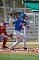 GCL Mets third baseman Kenny Hernandez (5) follows through on a swing during a game against the GCL Cardinals on July 23, 2017 at Roger Dean Stadium Complex in Jupiter, Florida.  GCL Cardinals defeated the GCL Mets 5-3.  (Mike Janes/Four Seam Images)
