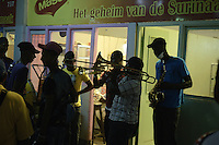 A street band plays for the merchants, shoppers in the Central Market of Paramaribo. This is a tradition in Suriname and the bands plays at different locations, places before  important days, festive start.....End of year 2010 celebrations on the streets of Paramaribo. Suriname is one of biggest consumer in South America that using firecrackers, fireworks ( also locally known as pagara ) for celebrations, especially for end of every years and also beginning of every new Chinese Years.