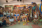 Kuikuro warriors with a young boy called Messi in their midst perform a traditional ceremonial dance at the International Indigenous Games in Brazil. 29th October 2015
