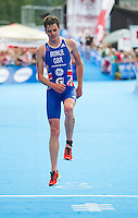 24 JUN 2012 - KITZBUEHEL, AUT - Jonathan Brownlee (GBR) of Great Britain bounds over the finish line to take second place at the elite men's 2012 World Triathlon Series round in Schwarzsee, Kitzbuehel, Austria  (PHOTO (C) 2012 NIGEL FARROW)