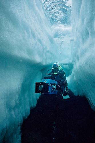 Doug Allan filming under the ice
