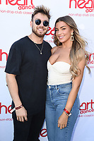 Sam Thompson and Zara McDermott<br /> arriving for the launch of new radio station Heart Dance at Global Radio, Leicester Square, London<br /> <br /> ©Ash Knotek  D3513  02/07/2019