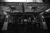"""Restaurants protest against the new rules and restrictions. <br /> <br /> Campo de' Fiori.<br /> <br /> Rome, 23/10/2020. Documenting the """"curfew"""" (coprifuoco) imposed from Friday night in Rome and its surrounding Lazio Region. The local authorities tightened rules and restrictions due to a spike in the Covid-19 / Coronavirus cases. 23 October bulletins sees 19.143 new cases, 91 people died, 182.032 tests made. Today, the President of Lazio Region, Nicola Zingaretti (Leader of the Democratic Party, PD, party member of the Italian Coalition Government), imposed the night curfew, from midnight to 5AM, for 30 days (1.). A new self-certification (autocertificazione, downloadable from here 1.) is needed to leave home which is allowed only for urgent reasons, mainly work and health. Furthermore, the Mayor of Rome, Virginia Raggi, implemented """"no-go zones"""" restrictions from 9PM in some of the areas and squares of the Eternal City famous for the nightlife, including Campo de' Fiori, Via del Pigneto, Piazza Trilussa in Trastevere district and Piazza Madonna de' Monti.<br /> <br /> Footnotes & Links:<br /> 1. http://www.regione.lazio.it/binary/rl_main/tbl_news/ordinanza_regione_lazio_intesa_Ministro_salute__mod_accettate_rev1__ore_24_1_signed.pdf<br /> <br /> March 2020, Coronavirus lockdown in Rome:<br /> - 12.03.2020 - Rome's Lockdown for the Outbreak of the Coronavirus In Italy - SARS-CoV-2 - COVID-19: https://lucaneve.photoshelter.com/gallery/12-03-2020-Romes-Lockdown-for-the-Outbreak-of-the-Coronavirus-In-Italy-SARS-CoV-2-COVID-19/G0000jGtenBegsts/<br /> - 07-23.03.2020 - Villaggio Olimpico Ai Tempi del COVID-19 - Rome's Olympic Village Under Lockdown: https://lucaneve.photoshelter.com/gallery/07-23-03-2020-Villaggio-Olimpico-Ai-Tempi-del-COVID-19-Romes-Olympic-Village-Under-Lockdown/G0000D2L9l0ibXZI/"""