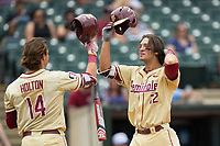 Drew Mendoza (22) of the Florida State Seminoles celebrates with teammate Tyler Holton (14) after hitting the first of two home runs on the day against the North Carolina Tar Heels during the 2017 ACC Baseball Championship Game at Louisville Slugger Field on May 28, 2017 in Louisville, Kentucky.  The Seminoles defeated the Tar Heels 7-3.  (Brian Westerholt/Four Seam Images)