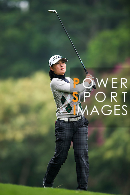 Lingling Tan of China in action during the Hyundai China Ladies Open 2014 on December 12 2014 at Mission Hills Shenzhen, in Shenzhen, China. Photo by Li Man Yuen / Power Sport Images
