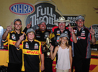 Jul. 1, 2012; Joliet, IL, USA: NHRA funny car driver Jeff Arend celebrates with team owner Connie Kalitta and the two sons of late driver Scott Kalitta and the crew after winning the Route 66 Nationals at Route 66 Raceway. Mandatory Credit: Mark J. Rebilas-