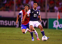 SAN JOSE, COSTA RICA - September 06, 2013: Michael Orozco (21) of the USA MNT moves the ball away from Cristian Bolanos (7) of the Costa Rica MNT during a 2014 World Cup qualifying match at the National Stadium in San Jose on September 6. USA lost 3-1.