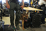 June 7, 2014: Security precautions on Belmont Stakes Day include a dog to sniff for signs of danger among the bags of photo equipment in the press room. Scene at Belmont Park on the morning of the Belmont Stakes, Elmont, NY ©Joan Fairman Kanes/ESW/CSM