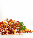 Cooked pasta with sauce, cheese and parsley