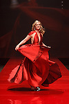 Actress Bonnie Somerville walks runway in a red dress by Carmen Marc Valvo, for the Red Dress Collection 2017 fashion show, for The American Heart Association, presented by Macy's at the Hammerstein Ballroom in New York City on February 9, 2017; during New York Fashion Week Fall 2017.
