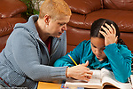 9 year old girl frustrated by math homework, mother going over directions with her