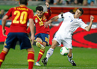 Spain's Cesc Fabregas and Finland's Roman Eremenko during international match of the qualifiers for the FIFA World Cup Brazil 2014.March 22,2013.(ALTERPHOTOS/Victor Blanco)