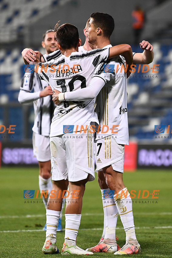 Cristiano Ronaldo of Juventus FC celebrates with Paulo Dybala after scoring the goal of 0-2 during the Serie A football match between US Sassuolo and Juventus FC at Citta del Tricolore stadium in Reggio Emilia (Italy), May 2nd 2021. Photo Image Sport / Insidefoto