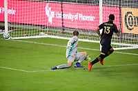 CARSON, CA - OCTOBER 28: Mohamed El-Munir #13 of LAFC crosses a ball past GK Marko Maric  #1 of the Houston Dynamo during a game between Houston Dynamo and Los Angeles FC at Banc of California Stadium on October 28, 2020 in Carson, California.