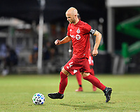 LAKE BUENA VISTA, FL - JULY 26: Michael Bradley of Toronto FC dribbles the ball during a game between New York City FC and Toronto FC at ESPN Wide World of Sports on July 26, 2020 in Lake Buena Vista, Florida.