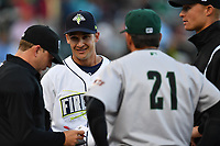 Manager Jose Leger (19) of the Columbia Fireflies speaks with the umpires before a game against the Augusta GreenJackets on Opening Day, Thursday, April 6, 2017, at Spirit Communications Park in Columbia, South Carolina. Columbia won, 14-7. (Tom Priddy/Four Seam Images)