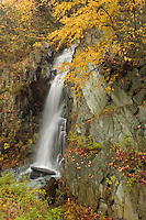 A waterfall on HWY 5 in Vermont near the Connecticutt River surrounded by fall foliage