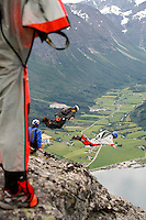 World Base Race, the first event where BASE jumpers compete to be the fastest flying down from a mountain, before deploying their parachute. The the contestants jump from a mountain in the fjord Innfjorden in Western Norway, two jumpers race each other to the finish line 750 meters horizontally from the mountain.