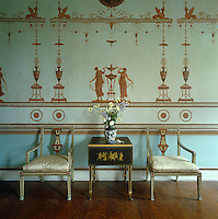 A pair of chairs flanks a sidetable in the Etruscan Dressing Room at Osterley Park, which features the work of Robert Adam's decorative artist, Pietro Mario Borgnis