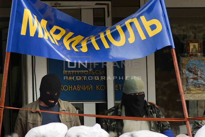 Pro-russian activists protest  in front of the Mariupol military base