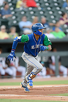 Shortstop Jeison Guzman (7) of the Lexington Legends runs toward first base in a game against Columbia Fireflies on Thursday, June 13, 2019, at Segra Park in Columbia, South Carolina. Lexington won, 10-5. (Tom Priddy/Four Seam Images)