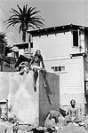 Three men on the beach Santa Barbara California. Muscles, surfing and meditation 1971 USA .