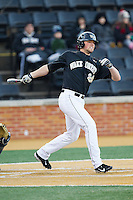 Charlie Morgan (24) of the Wake Forest Demon Deacons follows through on his swing against the Georgetown Hoyas at Wake Forest Baseball Park on February 16, 2014 in Winston-Salem, North Carolina.  The Demon Deacons defeated the Hoyas 3-2.  (Brian Westerholt/Four Seam Images)