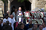 """© Joel Goodman - 07973 332324 . 28/08/2015 . Salford , UK . Mourners leave the church after the service . The funeral of Paul Massey at St Paul's CE Church in Salford . Massey , known as Salford's """" Mr Big """" , was shot dead at his home in Salford last month . Photo credit : Joel Goodman"""