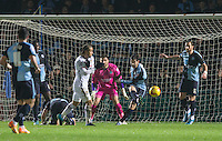 Joe Jacobson of Wycombe Wanderers clears danger during the Sky Bet League 2 match between Wycombe Wanderers and Notts County at Adams Park, High Wycombe, England on 15 December 2015. Photo by Andy Rowland.