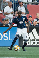 FOXBOROUGH, MA - SEPTEMBER 29: Luis Caicedo #27 of New England Revolution passes the ball during a game between New York City FC and New England Revolution at Gillettes Stadium on September 29, 2019 in Foxborough, Massachusetts.