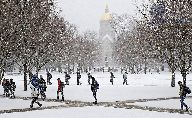 Feb. 20, 2013; Students walk across the Main Quad during class change. Photo by Barbara Johnston/University of Notre Dame