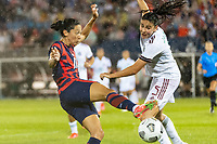 EAST HARTFORD, CT - JULY 1: Christen Press #11 of the United States battles for the ball with Jimena Lopez #5 of Mexico during a game between Mexico and USWNT at Rentschler Field on July 1, 2021 in East Hartford, Connecticut.