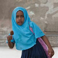 Zanzibar, Tanzania.  Young Muslim Girl Wearing a Scarf in Stone Town.