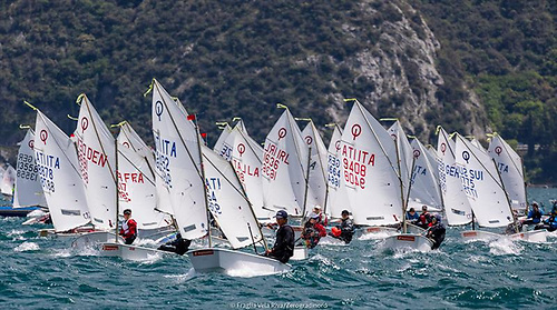 Right in the thick of it – Rocco Wright (IRL 1636) working his way through a very international fleet on Lake Garda