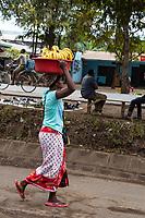 Tanzania.  Mto wa Mbu. Woman Carrying Bananas on Head.