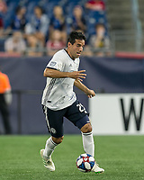 FOXBOROUGH, MA - JUNE 27: Ilsinho #25 dribbles at midfield during a game between Philadelphia Union and New England Revolution at Gillette Stadium on June 27, 2019 in Foxborough, Massachusetts.