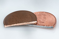 Cut halfs of a US 1957 mint copper wheat penny-- with over 95% copper--compared to a US 2015 mint penny, which is copper-plated zinc.