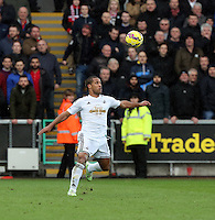 SWANSEA, WALES - FEBRUARY 21: Wayne Routledge of Swansea controls the ball with his chest during the Barclays Premier League match between Swansea City and Manchester United at Liberty Stadium on February 21, 2015 in Swansea, Wales.