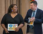 Tonya Miller and Robert Allen react during a Children at Risk awards presentation to area schools at Pilgrim Academy, June 6, 2016.