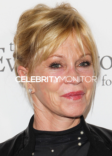 HOLLYWOOD, LOS ANGELES, CA, USA - OCTOBER 09: Melanie Griffith arrives at the Eva Longoria Foundation Dinner held at Beso Restaurant on October 9, 2014 in Hollywood, Los Angeles, California, United States. (Photo by Celebrity Monitor)