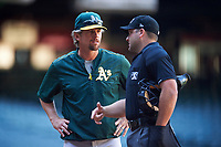 Oakland Athletics coach Aaron Nieckula questions a call with umpire John Mang during an Instructional League game against the Arizona Diamondbacks on October 15, 2016 at Chase Field in Phoenix, Arizona.  (Mike Janes/Four Seam Images)