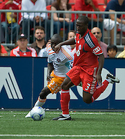 18 July 2009: Houston Dynamo forward Dominic Oduro #23 and Toronto FC defender Nana Attakora-Gyan #3 in action during a game between the Toronto FC and Houston Dynamo..The game ended in a 1-1 draw..