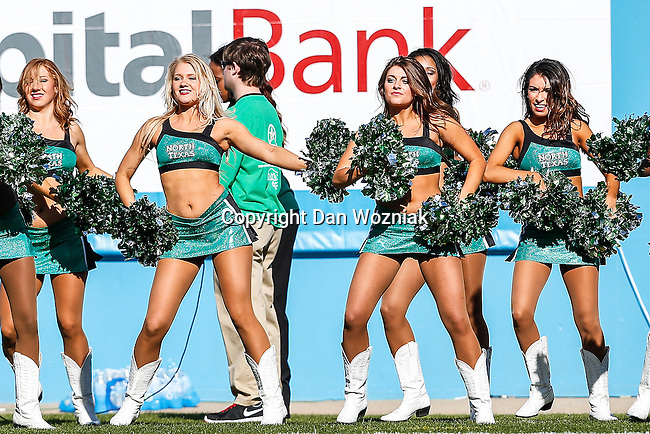 North Texas Mean Green cheerleaders in action during the Heart of Dallas Bowl game between the North Texas Mean Green and the UNLV Rebels at the Cotton Bowl Stadium in Dallas, Texas. UNT defeats UNLV 36 to 14.