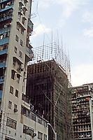 Hong Kong: Building with bamboo scaffolding. Photo '81.