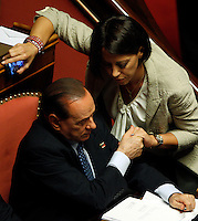 L'ex Presidente del Consiglio e senatore Silvio Berlusconi stringe la mano al Ministro delle Politiche Agricole e Forestali Nunzia De Girolamo prima del voto di fiducia al governo, al Senato, Roma, 2 ottobre 2013.<br /> Italian former Premier and senator Silvio Berlusconi shakes hands with Agriculture Minister Nunzia De Girolamo, right, prior to the confidence vote on the government, at the Senate, Rome, 2 October 2013.<br /> UPDATE IMAGES PRESS/Riccardo De Luca