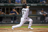 Nick Madrigal (3) of the Charlotte Knights follows through on his swing against the Scranton/Wilkes-Barre RailRiders at BB&T BallPark on August 13, 2019 in Charlotte, North Carolina. The Knights defeated the RailRiders 15-1. (Brian Westerholt/Four Seam Images)