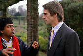 London, England. Ailton Krenak, Brazilian Indian leader, talking to Jeremy Irons in the Royal Botanic Gardens, Kew.