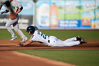 West Michigan Whitecaps left fielder Cam Gibson (23) slides into second base during a game against the Clinton LumberKings on May 3, 2017 at Fifth Third Ballpark in Comstock Park, Michigan.  West Michigan defeated Clinton 3-2.  (Mike Janes/Four Seam Images)