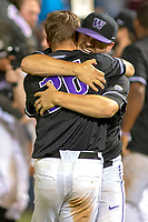 University of Washington Huskies Levi Jordan (26) and Alex Hardy (51) celebrate their tenth inning walk off win and their berth into the College World Series at Goodwin Field on June 10, 2018 in Fullerton, California. The Huskies defeated the Titans 6-5. (Donn Parris/Four Seam Images via AP Images)